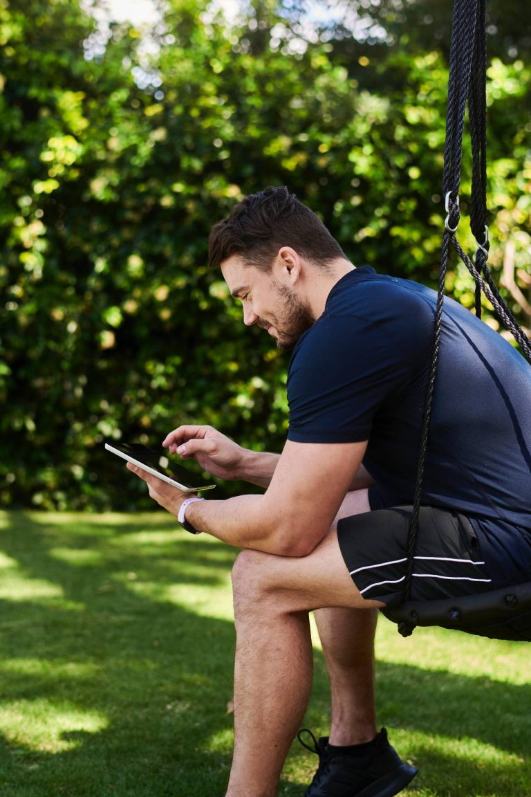 man in blue t-shirt reviewing contract on DocuSign from phone